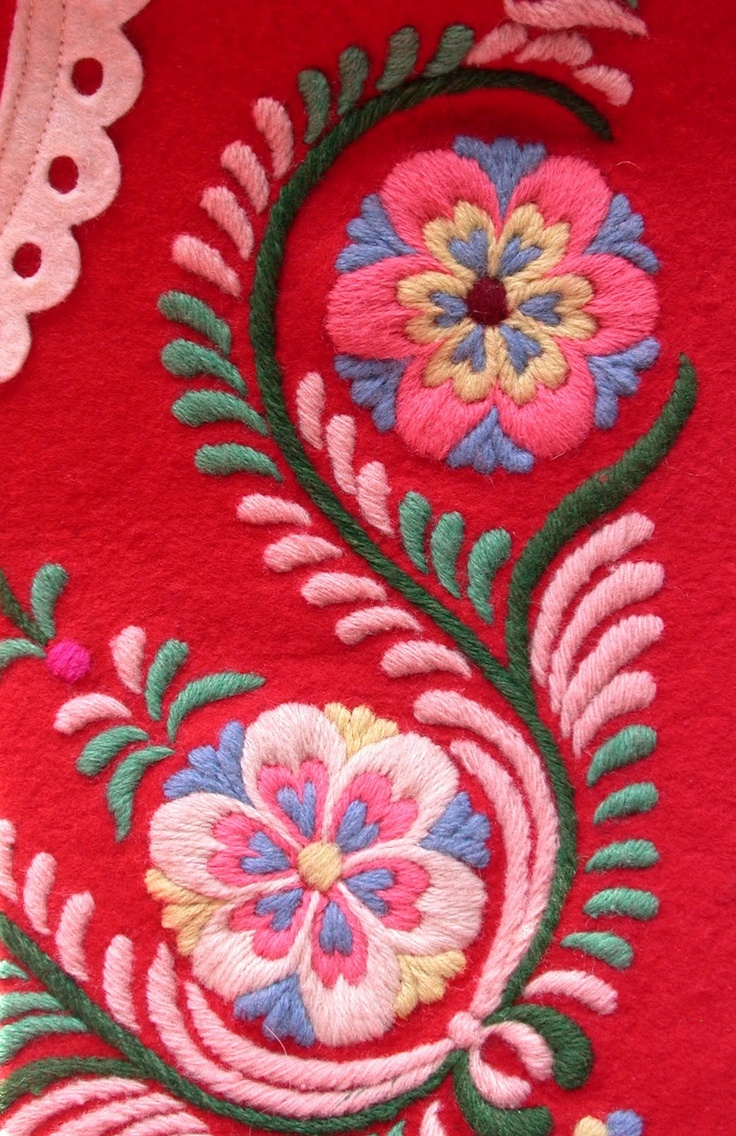 Love the thick satin embroidery over the dark red cloth.